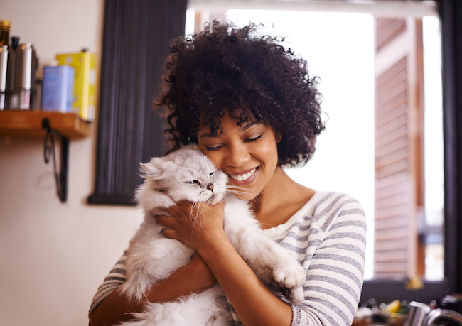 Shot of a beautiful young woman enjoying a cuddle with her cat