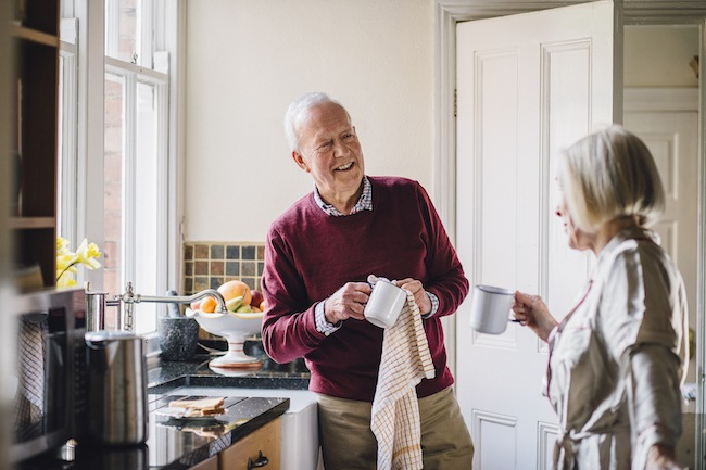 Older couple talking in kitchen