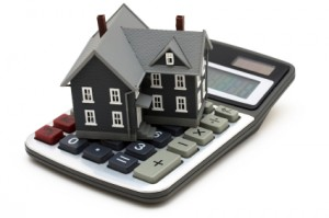 "house on calculator 300x199 Adjustable Rate Mortgage Terms You Should Know – ""ARM"" Yourself with Knowledge"