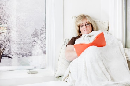 iStock winter window reading womanXSmall1 Beat Winter Blues by Planning for Summer