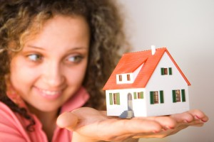 woman house in hand 300x200 Mortgage News from 2010: An Overview of Financial Events That Impacted You