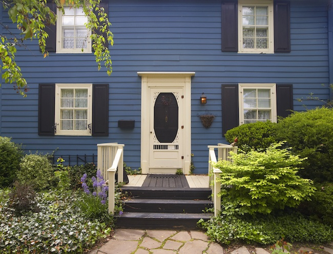 Blue house with a tan door