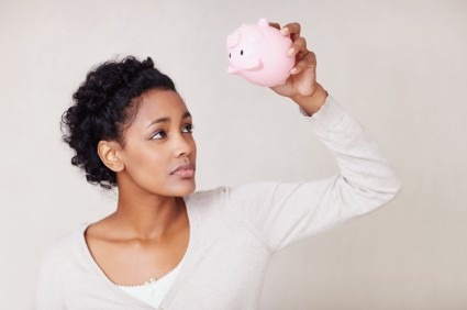 iStock womanpiggybankXSmall e1311349137796 Too Young to Start a Retirement Fund? Think Again.