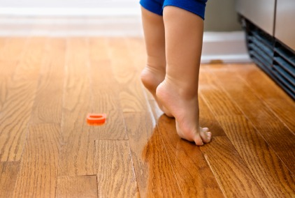 iStock Hardwood Floor Baby Feet XSmall Pros and Cons of Wood Floors