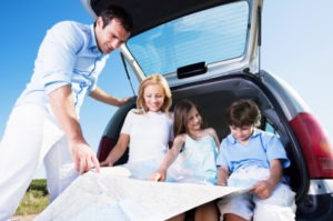 family traveling with map 300x199 7 Summer Vacation Ideas for the Kids