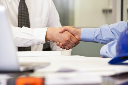 Shaking hands Questions to Ask When Looking for a Real Estate Agent