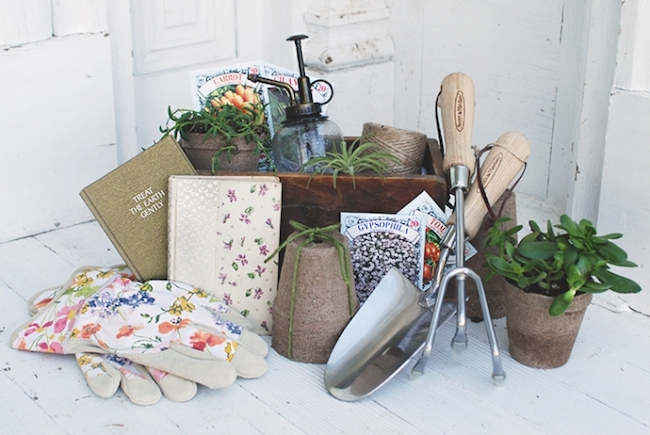 Housewarming gift basket stuff with gardening supplies