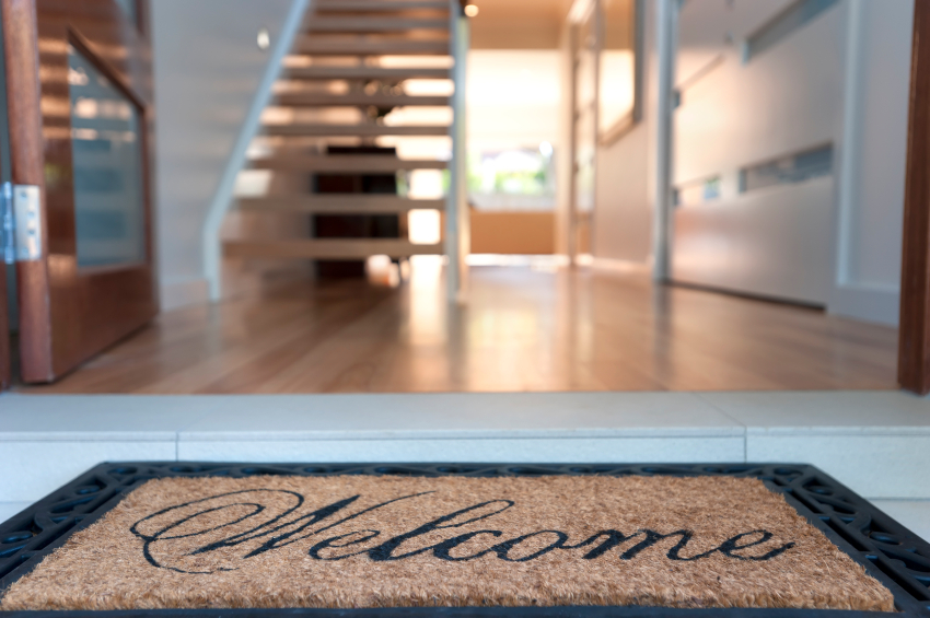 iStock Model Home Welcome Mat Small Model Homes: Potential Problems to Consider Before You Buy