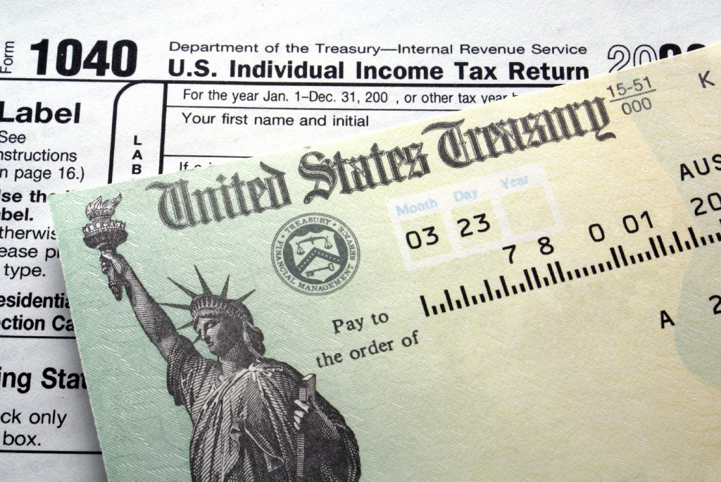 iStock 000003655048Medium 1024x684 Tax Refunds: Should You Spend or Save?