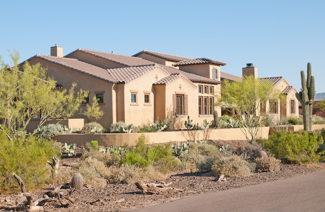 That s an interesting looking house pueblo style for Pueblo style home plans