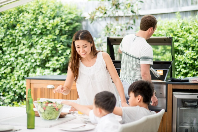 Family using outdoor kitchen