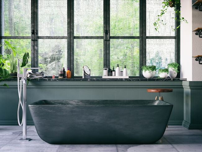 Dark green bathroom with soaking tub
