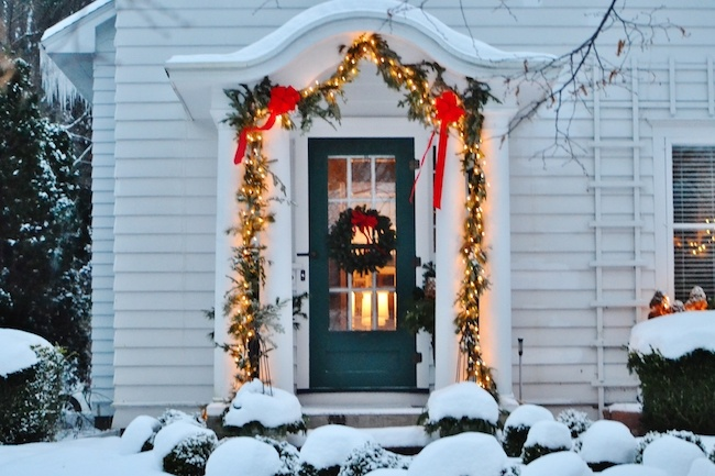 Holiday Lights Hanging Over A Front Door