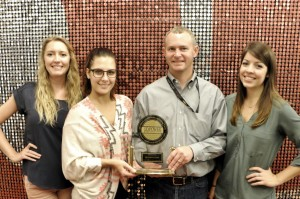 The Marketing Servicing Team proudly shows the J.D. Power award.