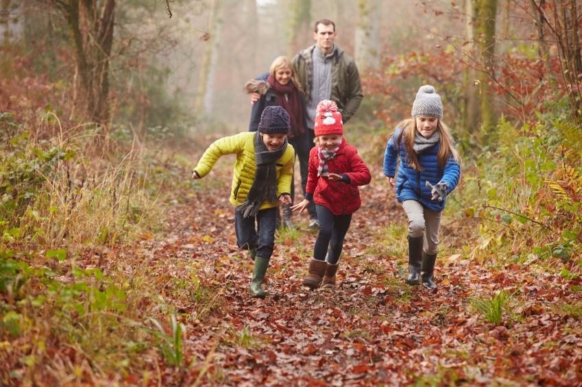 Family Walking Through Winter Woodland