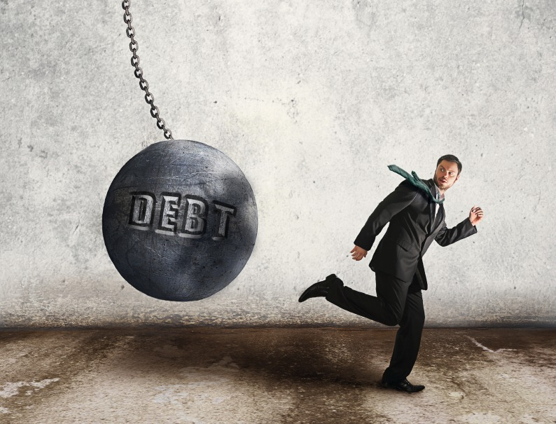 Man running from debt wrecking ball