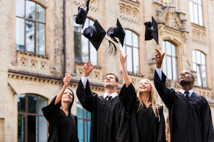 Graduates tossing their cap in the air