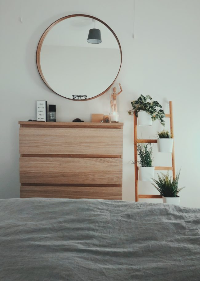 Minimal bedroom with round mirror