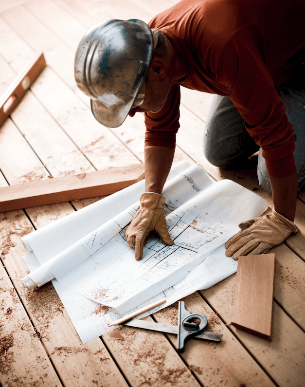 Contractor working on home improvement plans