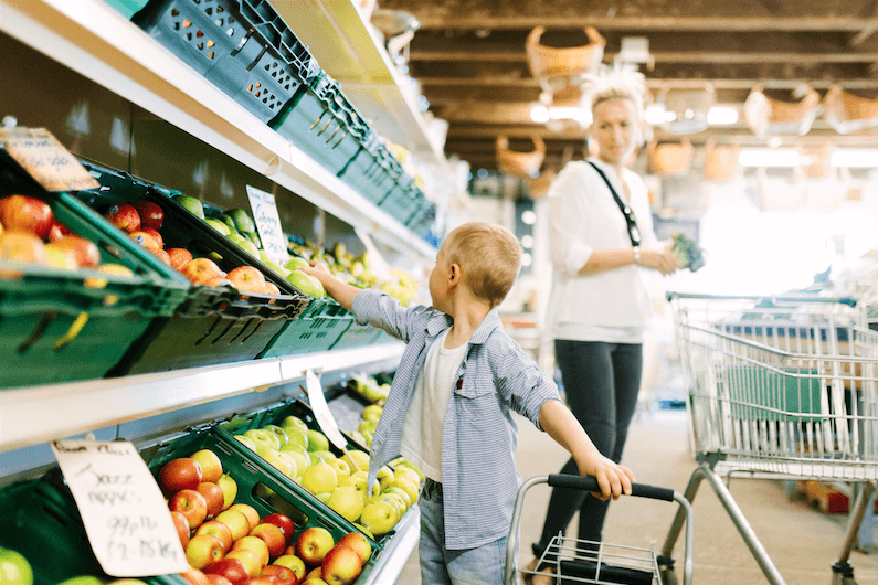 woman and son grocery shopping