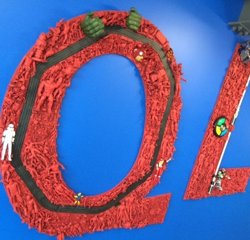 QL Logo Made Of Toy Action Figures At QL Tech Center