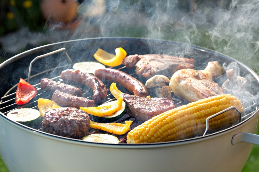 beef, sausage and vegetbales on smoky barbecue