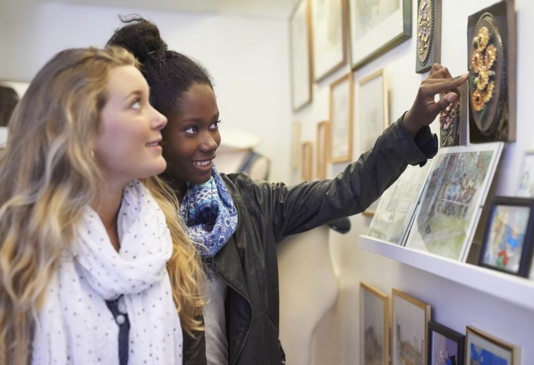 two women shopping for art