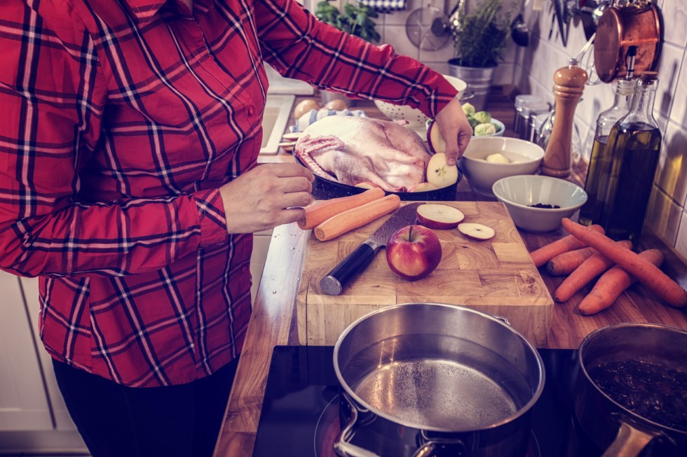 Woman cooking Thanksgiving dinner