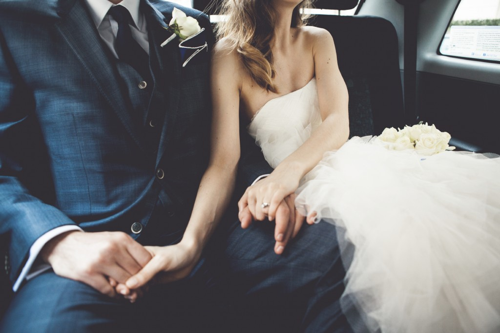 Bride and groom riding in car