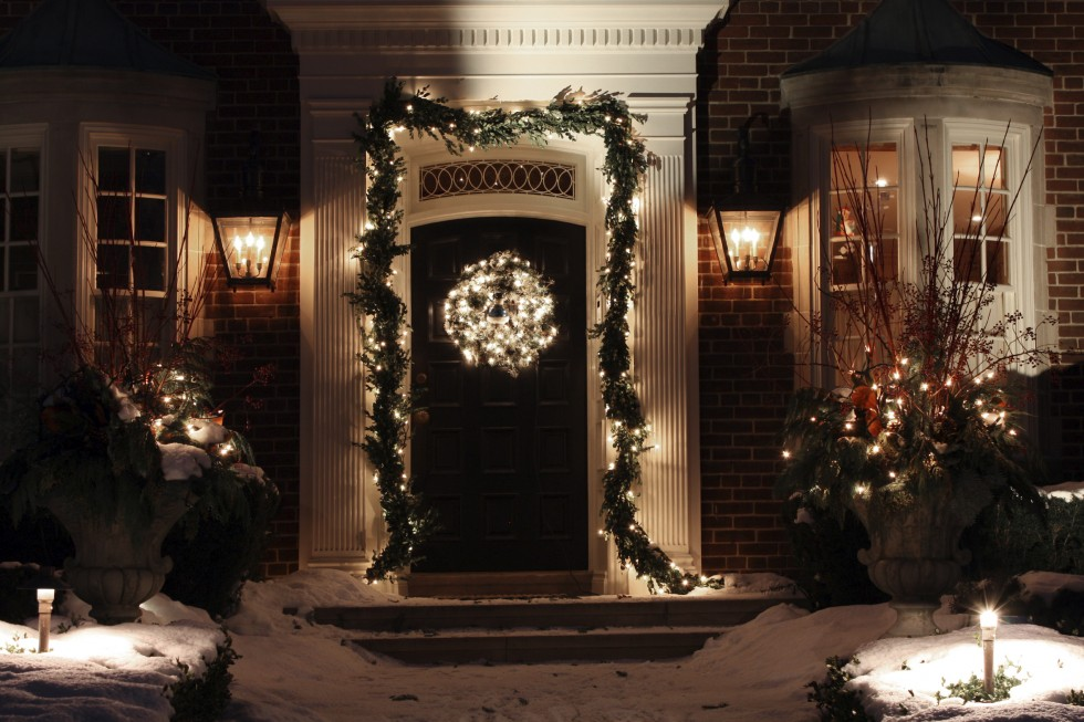 Front door decorated with holiday lights