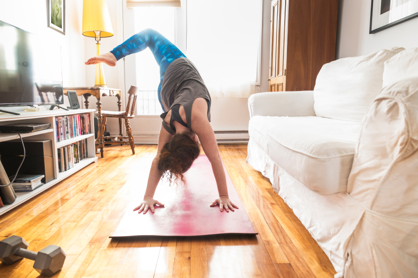 girl doing yoga in her house