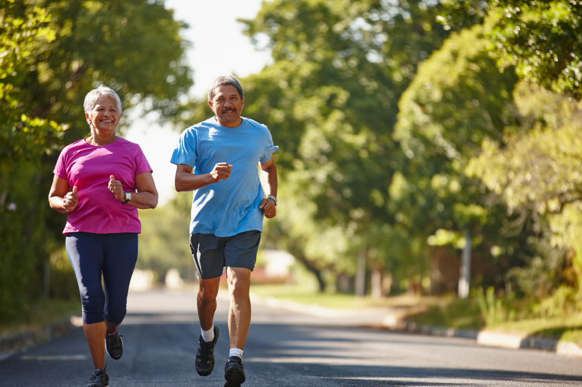 Couple running outside to keep fit