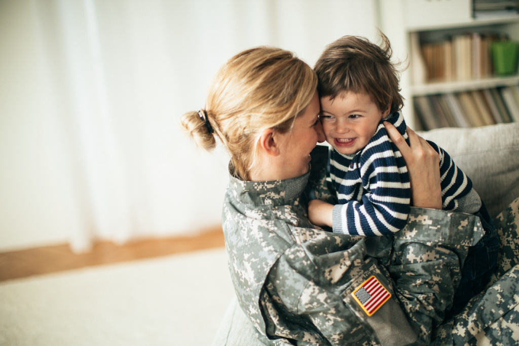 veteran mom holding son