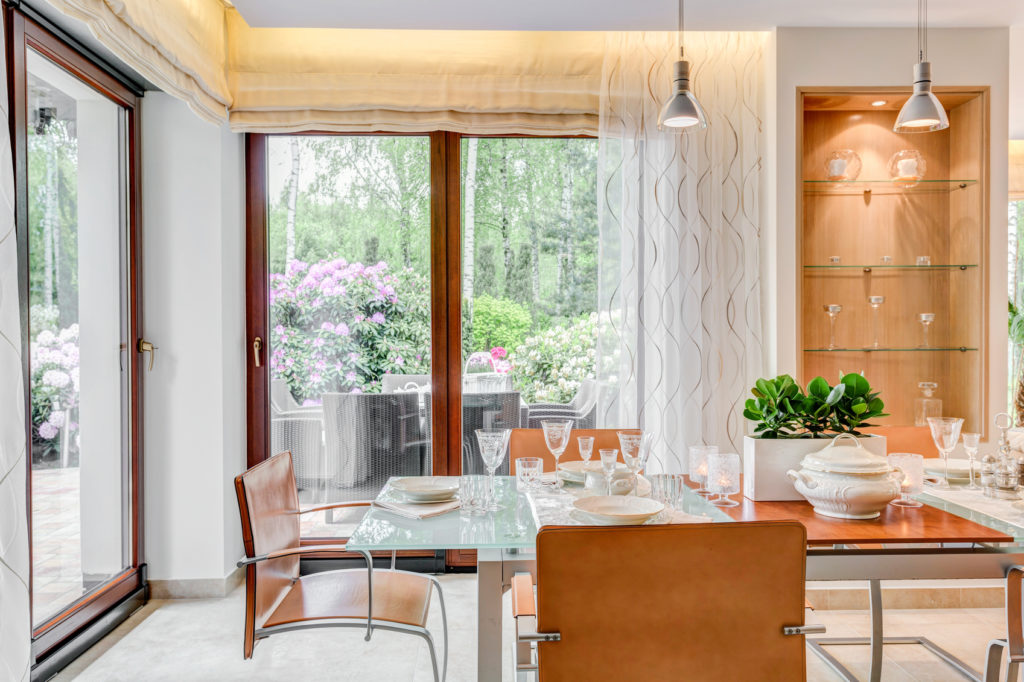 Modern style dining room with large windows