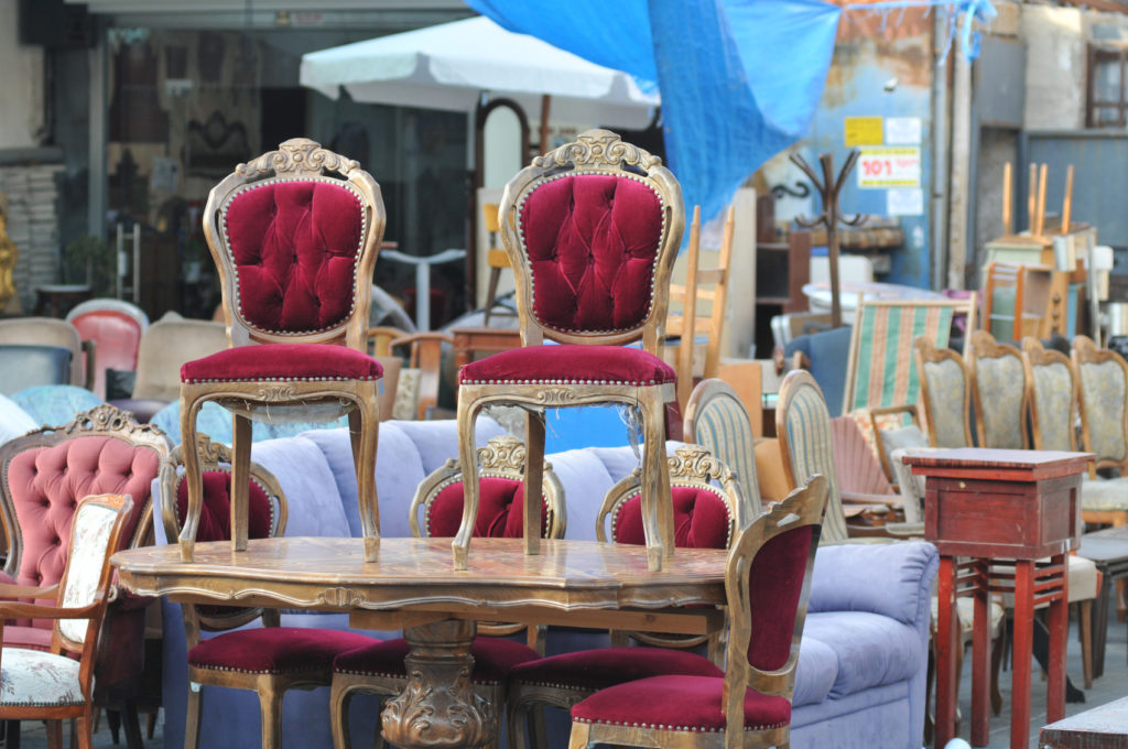 Antique Chairs on a table at flea market - How To Check For Pests Before Buying Used Furniture - ZING Blog By