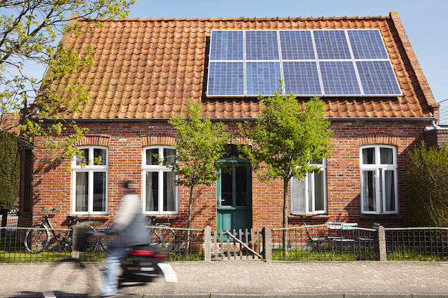 Little Traditional northern Brick house with solar panels
