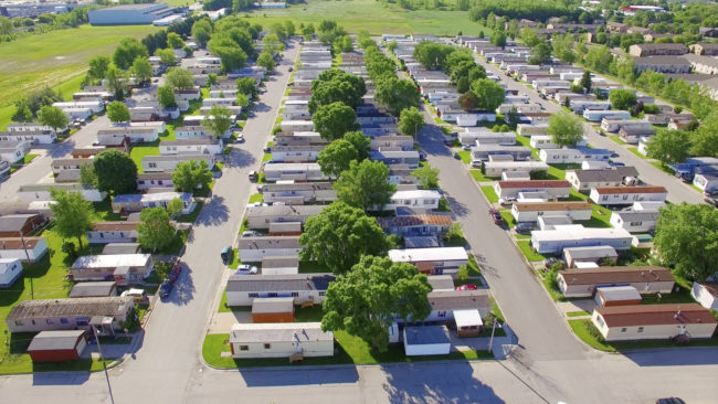 Vast Trailer Park Mobile Home Court On Sunny Summer Morning