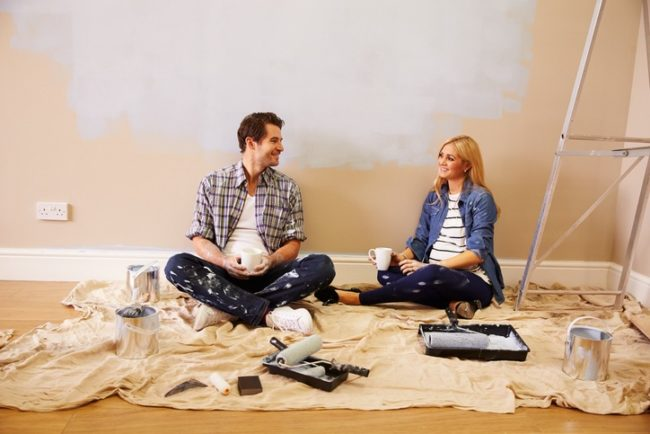 couple_sitting_on_the_floor_after_painting