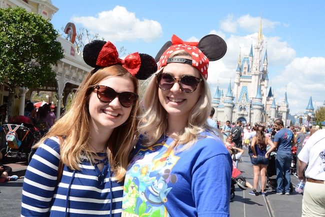 Two girls wearing Disney World mouse ears