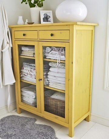 Bright yellow linen cabinet
