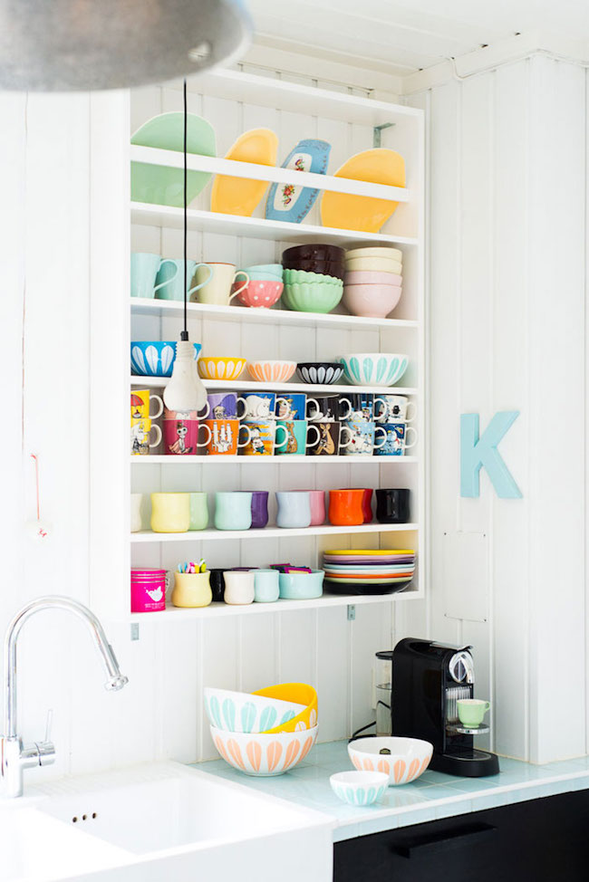 Colorful plate display in a kitchen