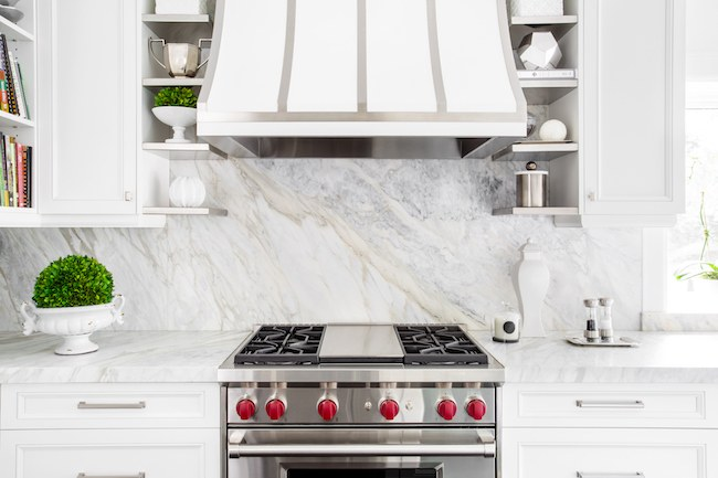 White kitchen with a marble backsplash