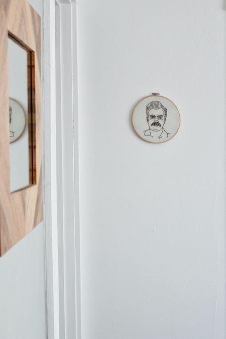 Hanging embroidery of Ron Swanson