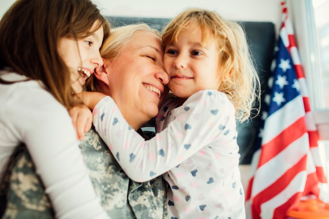 Mom veteran holding daughters