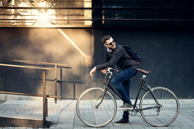 Businessman riding on bike