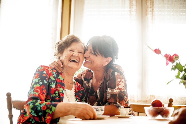 Woman caring for aging mother