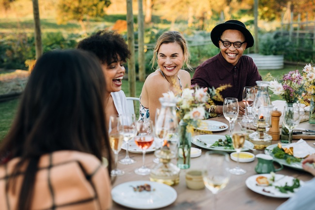 Group of friends enjoy outdoor dining