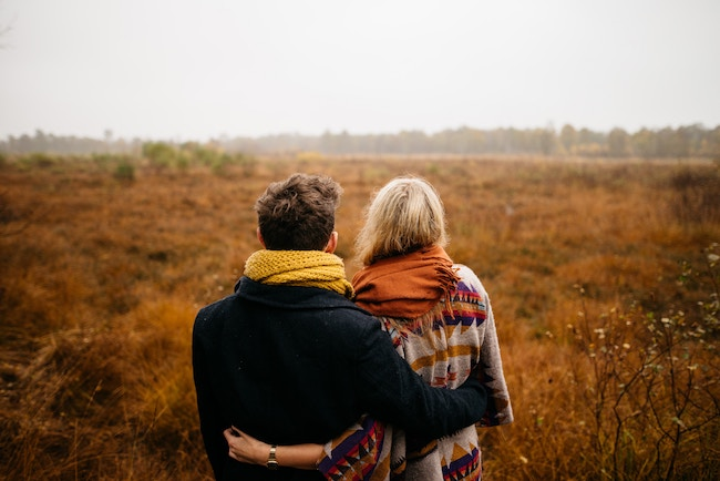 Couple looking at field