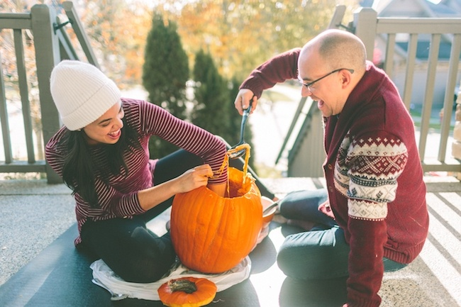 Couple carving pumpkins