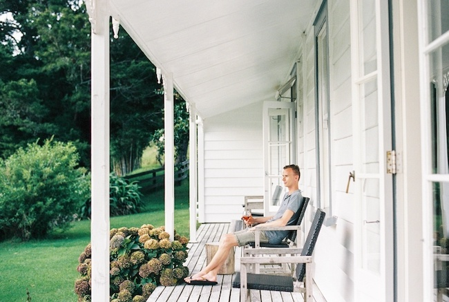 Man sitting on front porch